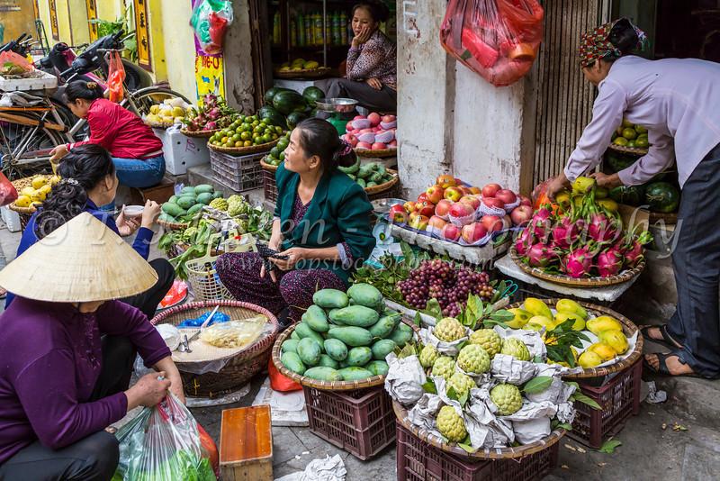 A street vendor selling fresh produce in Hanoi, Vietnam, Asia.