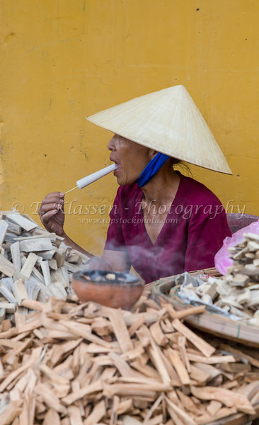 A lady selling incense at the Phuoc Kien Pagoda in Hoi An, Vietnam, Asia.