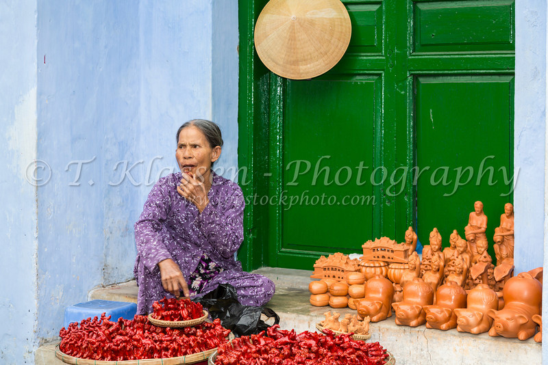 A lady at a street market in Hoi An, Vietnam, Asia.