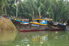 Fishing boats in the Thu Bon River near Hoi An, Vietnam, Asia.