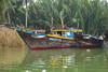 Fishing boats in the Thu Bon River near Hoi An, Vietnam, Asia.