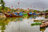 Colorful boats at the dock in Hoi An, Vietnam, Asia.
