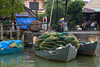 Fishing boats at the dock on the Thu Bon River near Hoi An, Vietnam, Asia.