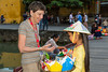 Esther Anne buying a floating candle from a little girl in Hoi An, Vietnam, Asia.