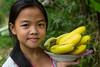 A young girl selling bananas at the Minh Mang Tombs near Hue, Vietnam, Asia.