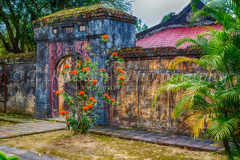 The Minh Mang Tomb complex of gates, buildings and statues near Hue, Vietnam, Asia.