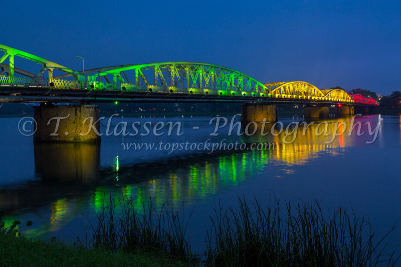 The Truong Tien Bridge across the Perfume River illuminated at night in Hue, Vietnam, Asia.