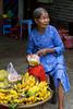 An elderly lady selling fruit at the Thien Mu Pagoda near Hue, Vietnam, Asia.
