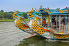 Tourboats with dragon heads along the Perfume River near Hue, Vietnam, Asia.