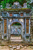 A rustic weathered gate at the Tu Duc Emperors tomb near Hue, Vietnam, Asia.