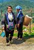 Two Black Hmong ladies in Cat Cat village near Sapa, Vietnam, Asia.