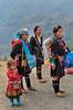 Black Hmong girls in ethnic dress in Lao Chai Village near Sapa, Vietnam, Asia.