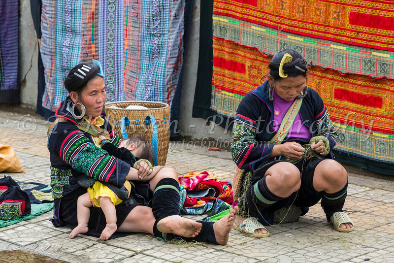 The town market with Hmong hill tribe people in ethnic dress in Sapa, Vietnam, Asia.