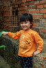 A young girl posing at the Tay Phuong Pagoda near Hanoi, Vietnam, Asia.