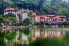The village lake, Long Chieu at the Thay Pagoda (Masters Pagoda) located at the foot of Sai Son mountain near Hanoi, Vietnam, Asia.