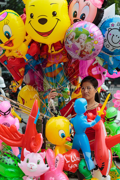 Selling party balloons on the street in Hanoi, Vietnam, Asia.