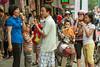 Eating ice cream on the street in downtown Hanoi, Vietnam, Asia.
