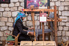 A Hmong hill tribe lady weaving at the Victoria Sapa Resort in Sapa, Vietnam, Asia.