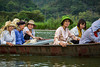 Rowboats transport people along the Yen River to the Perfume Pagoda near Hanoi, Vietnam, Asia.