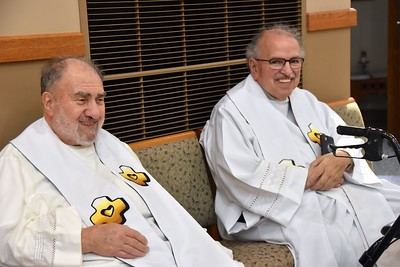 Fr. Tony Russo, left, was pastor when the Vietnamese worship community first came to St. Martin of Tours. He was followed by Fr. Yvon Sheehy (right).