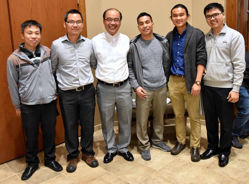 Fr. Quang Nguyen with a few of our students