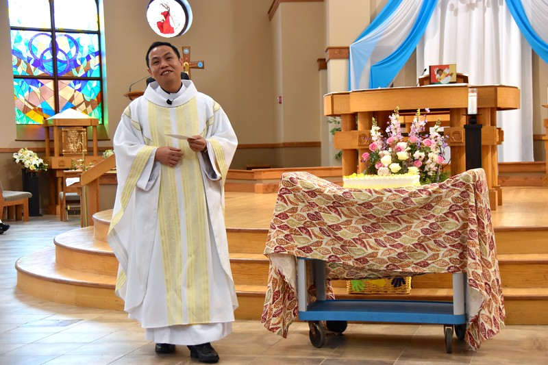 Fr. Joseph Quang Tran with his birthday cake