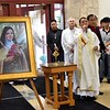 Fr. Joseph Quang explains the opening procession. Behind him is Fr. Terry Langley, pastor of St. Martin of Tours. The image is of St. Theresa, the patron saint of the community.
