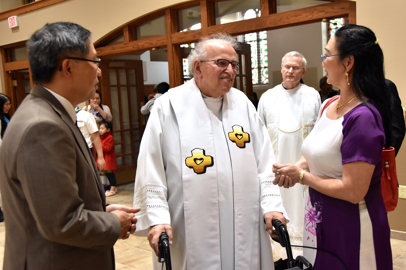 Fr. Yvon talks with parishioners