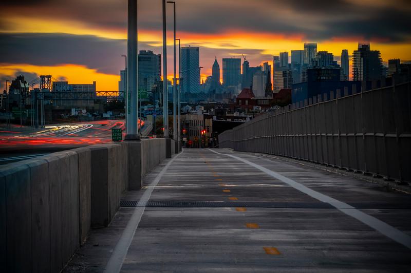 Sunset Of Manhattan From Bridge Walkway