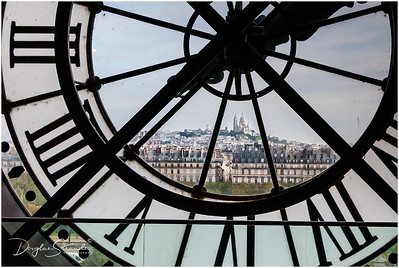 Sacre-Couer seen through the Orsay Museum Clock