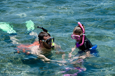 Mike and Sophia snorkeling by the dock at our house