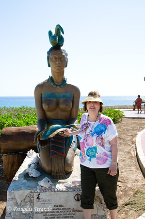 Louise posing with a statue at Punta Sur, the southern tip of Isla Mujeres
