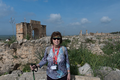 Louise by Roman ruins at Volubilis