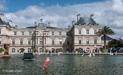 Children play with boats in the fountain at Luxembourg Palace