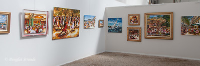 Paintings displayed in an open gallery.