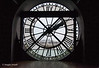 A city view through the Orsay Museum clock, from the inside.