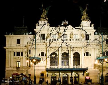 A Prague theater, at night