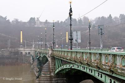 Bridge over Vlatava River, Prague.  Metronome on distant hill, replaces Stalin's statue.