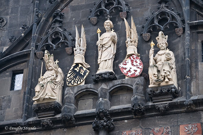 Decorative statues on the tower entrance to Charles Bridge