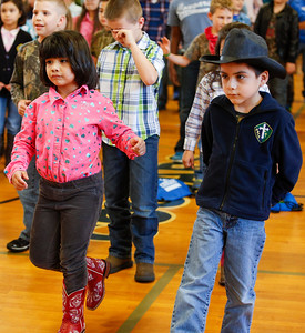 Ana Ammer & Julian Moran kick up their heels at Go Texan Day. Holy Rosary Go Texan Day, January 30, 2015; Holy Rosary Catholic School, Rosenberg, Texas