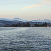 Looking up Gareloch to setting sun striking snow peaks