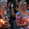 "Saugus, Ma. 9-14-17. Danielle Parente, left, and Caren Turner, right, listening to Debbie Alimonti talk about her late sister Susan Taraskiewicz during a vigil  to her called ""Remembering Su"" on the 25th year of her death in a ceremony held at World Series Baseball Park in Saugus."