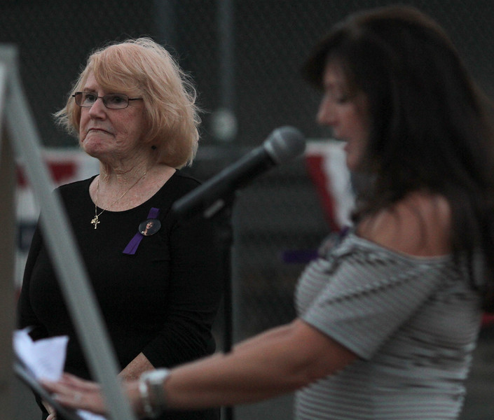 "Saugus, Ma. 9-14-17. Marlene Taraskiewicz, left, the mother of the late Susan Taraskiewicz who was murdered 25 years ago, listens to her daughter Debbie Alimonti, right, talk about Susan's life at a vigil called ""Remembering Su"" at a ceremony held at at World Series Baseball Park in Saugus."