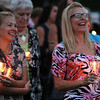 Saugus, Ma. 9-14-17. Danielle Parente, left, and Caren Turner, right, listening to Debbie Alimonti tell funny stories about her late sister Susan Taraskiewicz during a vigil to her memory on the 25th year of her death in a ceremony held at World Series Baseball Park in Saugus.