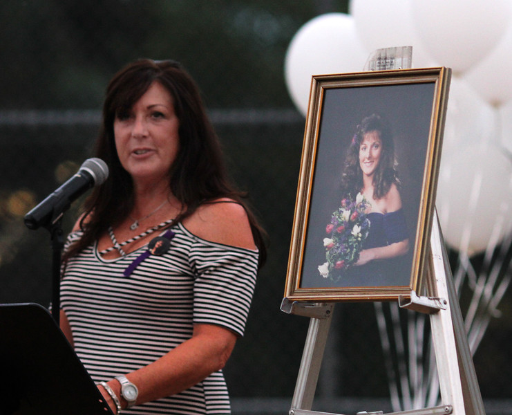 Saugus, Ma. 9-14-17. Debbie Alimonti, the sister of Susan Taraskiewicz who was killed 25 years a go, talks about her late sister during a vigil to her memory on the 25th anniversary of her death in a ceremony held at World Series Baseball Park in Saugus.