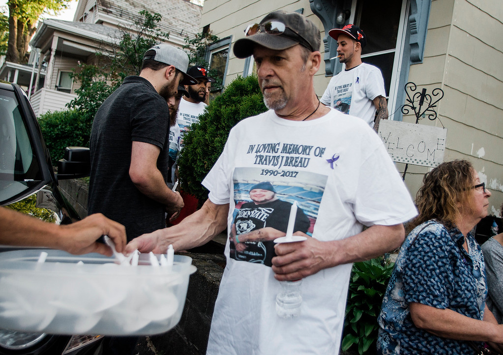 . Ron Breau, the father of Travis Breau, who died of a drug overdose in early May, hands out candles during a vigil held in his son\'s honor on Friday, May 19, 2017. SENTINEL & ENTERPRISE / Ashley Green