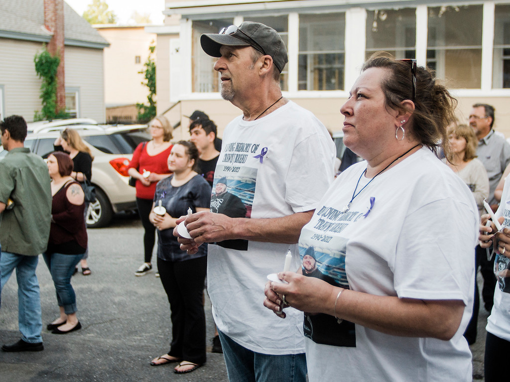 . Penny Mauch and Ron Breau, the parents of Travis Breau, who died of a drug overdose in early May, listen to speakers during the candlelight vigil held in his honor on Friday, May 19, 2017. SENTINEL & ENTERPRISE / Ashley Green