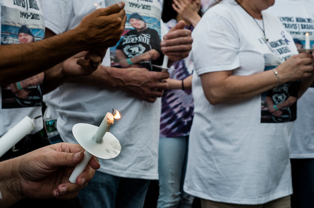 . Loved ones light candles in memory of Travis Breau, who died of a drug overdose in early May, during a vigil held in his honor on Friday, May 19, 2017. SENTINEL & ENTERPRISE / Ashley Green