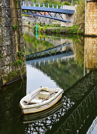 White Row Boat Under the Bridge