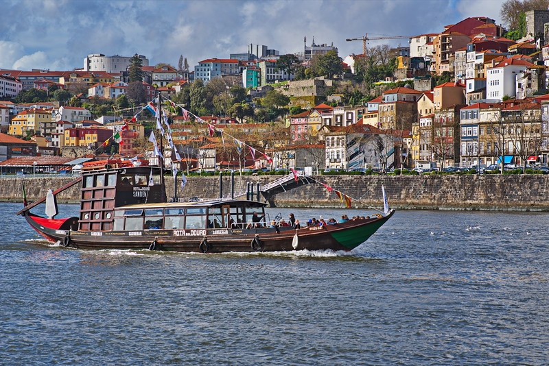 One of the most popular symbols of Porto is the Rabelo boat. These flat boats, nowadays laying quietly by the riverside, used to be the nautical horses that carried barrels of Porto wine from the Douro valley vineyards to the Port Wine cellars in Vila Nova de Gaia. For centuries, when there were no suitable roads or a single railway alongside the vineyards, Rabelo boats were the most efficient and reliable mode of transportation, if not only for their exclusivity.